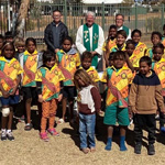 Bishop Charles Gauci with schoolkids Santa Teresa 150