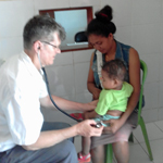 Br John Alting SVD with patients at a clinic in Timor Leste 150