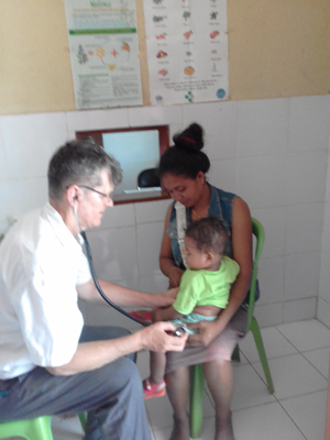Br John Alting SVD with patients at a clinic in Timor Leste 300