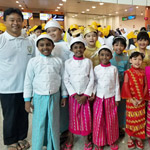 Pope in Myanmar Fr John with group 150